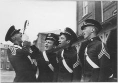 A cadet sword swallower shows off for his fellow classmates.