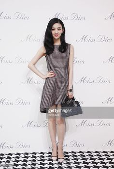 Jing Tian poses for a picture at Miss Dior Exhibition on June 19, 2014 in Shanghai, China.
