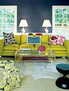 Love this room. The navy walls coupled with its opposite, yellow, make for an energetic and inviting space.