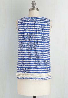 How do you adore this silky, printed top? You cherish each and every one of its lovely details! From its abstract, wavy pattern to its crocheted trim, this sapphire-blue and white blouse touts endless charm.
