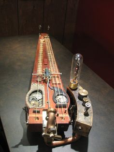 Let's bend the rules, steampunk cigar box guitar Resonator Guitar, Fender Guitars, Bass Guitars, Guitar Art, Cool Guitar, Guitar Pins, Cigar Box Projects, Nerf, Lap Steel Guitar