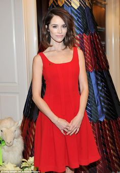 Lady in red: Abigail Spencer was unmissable in an elegant bright red dress which showed of...
