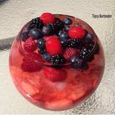 Jungle Juice Fishbowl (Red)  2 oz. Pinnacle Red Berry Vodka 2 oz. Pinnacle Tropical Punch Vodka 2 oz. Citron Vodka  2 oz. Triple Sec Base with Strawberries, add ice and Lemon Slice Pour Triple Sec, Shake Vodkas with Hawaiian Punch Lemon Berry Squeeze  Garnish with Raspberries (red and blue) ,Blueberries, and Cherries