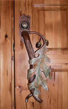 "Leaf door handle with acorns cascading down from the top of the stem (...or handle.) Love naure? It would look  great on a log cabin door or even a house located somewhere in the hills, moutains, forest, etc. Maybe on a door at a family ""summer house?"" Use your imagination!!!!!"