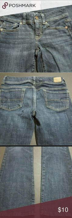 """AMERICAN EAGLE WOMEN'S 0 STRETCH BOOTCUT JEANS AMERICAN EAGLE SIZE 0 STRETCH BOOTCUT  These are a great condtion pair of stretch denim jeans from American Eagle Outfitters. These are a Women's size 0. These are a dark wash and an original bootcut style. With the jeans laying flat, the waist measures 14.5"""" and the inseam measures 31"""". These are pre-owned and some signs of wear/use should be expected.? American Eagle Outfitters Jeans Boot Cut"""