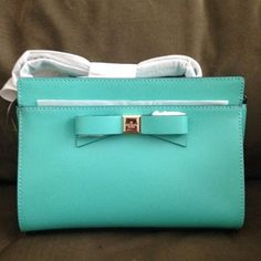 Kate Spade Tiffany blue Crossbody Kate Spade adorable Crossbody bag. Shoulder strap. Hidden pocket in front by the bow. Used for about a month but I am selling because I found another bag that is a little bigger. It is in great shape. Has a tiny tear on the inside pocket but you can barley notice. I loved this bag and I know you will too! Make an offer and I'll see what I can do! Price always negotiable. Comes with dust bag. kate spade Bags Crossbody Bags