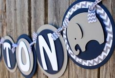 """Welcome your little peanutinto the world with this adorable """"It's a Boy"""" elephant banner. Colors: navy, gray, white Length: Varies - Circles measure 6 inches"""
