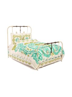 I like the rustic headboard and the colorful bed spread! They compliment eachother well.:)