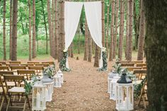 Amazing ceremony setup for a wedding in the woods with greenery and white curtains for a backdrop!  Photography: Clean Plate Pictures - cleanplatepictures.com  Read More: http://www.stylemepretty.com/2014/12/11/rustic-summer-wedding-at-roxbury-barn/