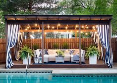 outdoor rooms pool cabana makeover - white and grey outdoor sectional, blue and white throw pillows and striped outdoor drapes make for a coastal pool vibe. Backyard Cabana, Pool Gazebo, Pool Cabana, Backyard Pool Designs, Outdoor Cabana, Outdoor Drapes, Outdoor Rooms, Outdoor Living, Outdoor Pool Areas