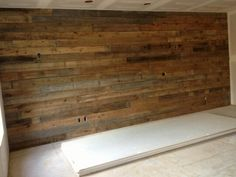 This barnwood wall makes the perfect accent wall in this master bedroom!