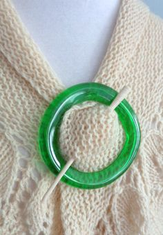 Shawl pin made from kiln-formed glass ring cut from Perrier bottle, upcycled, recycle