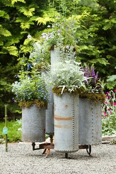 Looks like old stove pipe. LongHouse Reserve Planters. Photo via the blog, paradis express.