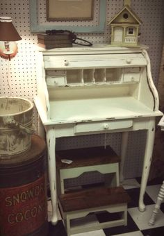 A small white roll top desk. Perfect for a small room or tight space. Price: $120