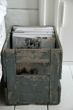 A little distressed paint treatment can make a new crate look vintage.