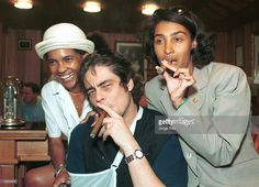 Actor Benicio del Toro, Oscar winner for Best Supporting Actor in the film 'Traffic,' smokes a cigar with Partagas employees Tamara Caves, left, and Elda Pichardo July 9, 2001 in Havana, Cuba. Del Toro is in Cuba at the invitation of the Cuban Institute of Cinematography and is accompanied by producer Laura Conde Bickford, director Steven Soderbergh and New York Times journalist Timothy Golden.