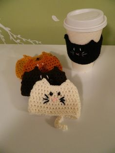 crochet kitty coffee cozy -- inspiration or items for purchase and like OMG! get some yourself some pawtastic adorable cat apparel! Crochet Coffee Cozy, Crochet Cozy, Diy Crochet, Crochet Crafts, Yarn Crafts, Crochet Hooks, Crochet Projects, Crochet Ideas, Coffee Cup