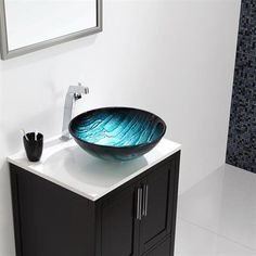 Ladon Glass Vessel Sink by Kraus: Such a unique sink inspired by the peaks of a glacier.