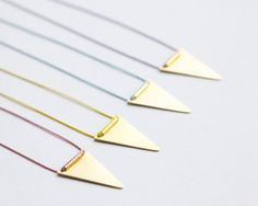 Triangle and silk necklace brass pennant and silk string by Filoe, $22.00