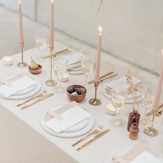 B.loved blogs most amazing modern wedding features of 2018. Classic tablescape/ wedding table setting with neutral palette styled by L27 weddings using peach tapered candles, wooden bowls, white plates and gold brass cutlery from H&M. Linen by natural dye works. Venue: Holme Flower Farms. Fine art wedding photography by Cristina Ilao Photography #Regram via @BsShmOMhNUq