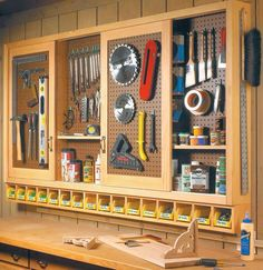 Workshop sliding door pegboard software storage.   Plans: www.woodsmithshop.......  Check out more by going to the photo