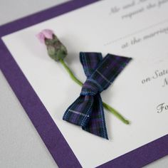 £2.25 Tartan Thistle Wedding Invitation Perfect for your Scottish themed wedding!This elegant invitation is made with quality white textured card mounted onto cadburys purple shimmer cardThen decorated with a mulberry paper thistle and complete with Pride of Scotland tartan bowThe invitations are 148 x 105mm in size and come with white envelopesMatching Stationery or different colour options availableTo personalise your order please email info@angelfins.co.uk