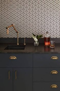 SEE ALL   |   9 OF 12  Choose an intricate pattern. This tight, Art Deco-inspired pattern works perfectly with this flexible faucet. It's a surprising choice that really catches the eye.   Geo Wallpaper  $26.99     marta double old-fashioned  $1.95     joyce bud vase  $2.95   Previous  PHOTOGRAPHY BY DESIRE TO INSPIRE  Next