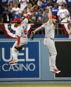 Matt Holliday and Jon Jay celebrate after defeating the Dodgers 10-9 in game 1 of the NLDS--Oct. 3, 2014
