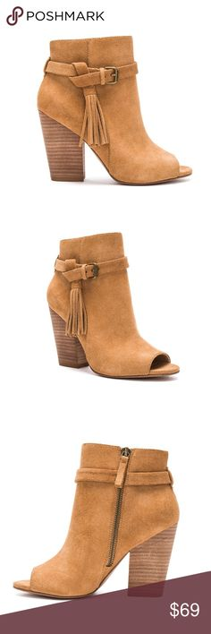 Joe's Jeans Celina Boot Own the town in the Celina bootie by Joe's Jeans Footwear. The soft and simplistic suede upper is interrupted with flirty fringe detail and a decorative strap and buckle for this season's must-have style. Joe's Jeans Shoes Ankle Boots & Booties
