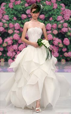 I love this skirt on this Wedding Dress It looks like the flower petals on Tiana Dress. What a rare dream dress for a Princess and the Frog Themed Wedding!