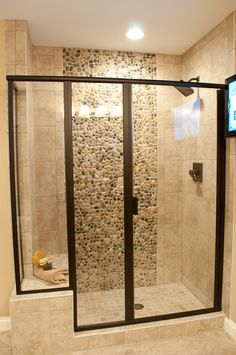 I would do all clear glass and white tile, but I like the shape of the glass with the seat.
