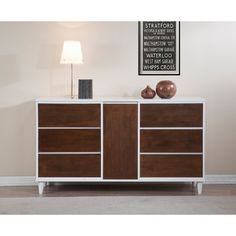 I really like the simplicity of this one.  maybe painted a bolder color instead of the white? Calvin Tobacco Dining Room Buffet