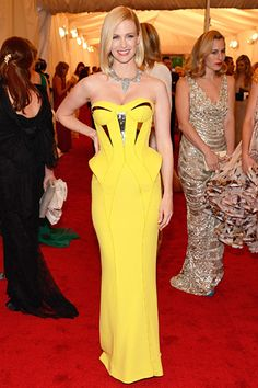 January Jones at the Met Costume Gala: Never one to play it safe on the red carpet, the Mad Men actress posed in an eye-popping yellow Versace gown with reflective accents and a Cartier statement necklace.