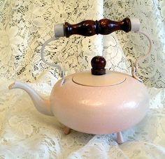 Small pink tea kettle