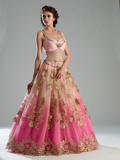 This Indo Western gown is in net and crepe fabric. Upper layer of net is of baby pink color and inner layer is of pure crepe double shaded pink color. Yoke part is embellished with silver and pink col