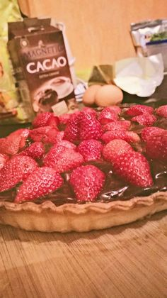tarte with creme chocolate covered gelly of herb filled strawberries .