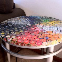 DESCRIPTION  Heres a new beer bottle cap mosaic table with silver aluminum frame/legs that features a few hundred hand-flattened bottle caps