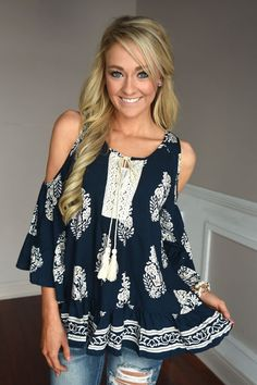 This gorgeous navy top is whimsical and boho!  True to size with a slightly looser fit. Model is 5'5'' a...
