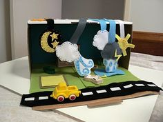 I made this simple diorama using an old postage box for the girls to learn more about weather . I used felt to create the weather elements b. Shoe Box Diorama, Letter W Activities, Weather Science, Weather Change, Science Art, Toy Chest, Storage Chest, Lettering, Learning