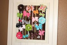 Cute bow holder...also cute brush w/ mod podge and scrapbook paper