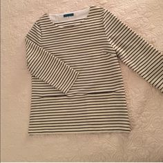 Piperlime stripe tee Perfect condition, no visible flaws! Striped top is wardrobe staple! Piperlime dust bag included. Nice weight, could transition well from work to dinner/drinks. True medium with slightly boxy fit. Black,cream with subtle gold stitching. 2 front pockets. Middle pic shown for fit, other pics are of the actual shirt. Rayon/ polyester blend, hand wash Pim and Larkin Tops