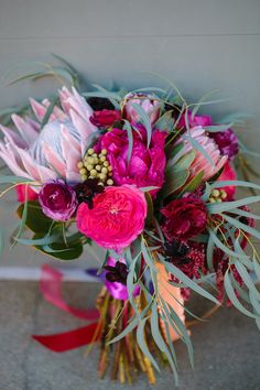 fuchsia bouquet - photo by Photos by Heart http://ruffledblog.com/summer-garden-wedding-ideas-in-chattanooga #weddingbouquet #flowers #bouquets