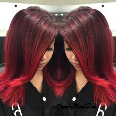 Give your locks a jolt with this fiery red ombre with hints of purple. See the coloring and styling essentials featured here for inspiration.
