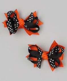Add a little festive flair to hair with these brilliant bows. Boasting pattern-packed ribbons on trusty alligator clips, they'll dress tresses without any pinch or pull.