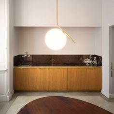 The Flos IC suspension light by designer Michael Anastassiades is available in two sizes; the smaller and the larger Finished in either brushed brass, black or chrome with opal glass diffuser Kitchen Interior, Suspension Light, Hanging Lights, Lamp, Kitchen Lighting Fixtures, Ceiling Lights, Light, Flos, Brass Pendant Lamp
