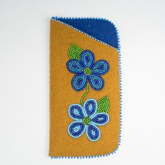 A handmade holder for your glasses, made of stroud and a beaded blue floral pattern.Hand crafted with care in Fort Liard, Northwest Territories in Canada's far North, this product supports the traditional aboriginal arts and crafts industry. Support Canadian aboriginal goods and buy online today.