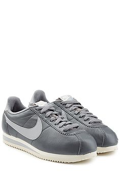 Cool grey with a paler swoosh, these iconic but understated Nike sneakers are a cool pair for weekend style #Stylebop