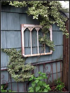 love...love...love old windows. Old ladders, old wagons. old chairs... they all look great in the garden!