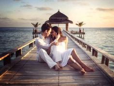 Take a trip to Maldives to experience the Essence of the Turquoise Blue Beaches in the Exotic Islands. Romantic Photography, Couple Photography Poses, Blue Beach, Beach Fun, Matrimonial Services, Maldives Travel, Maldives Tour, Honeymoon Planning, Wedding Planning