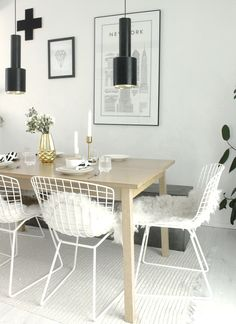 wire chairs with sheepskins